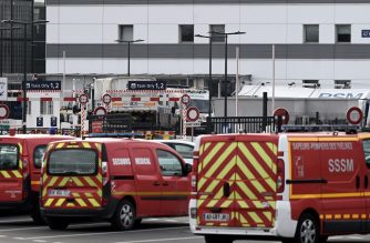 This picture shows French firefighters vehicles parked on April 2, 2020, at Paris Orly Airport transformed into an emergency evacuation air base to transfer patients contaminated by the COVID-19, the novel coronavirus, to other hospitals in France. (Photo by Philippe LOPEZ / AFP)