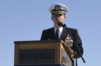"This handout photo released by the US Navy shows Captain Brett Crozier addressing the crew for the first time as commanding officer of the aircraft carrier USS Theodore Roosevelt (CVN 71) during a change of command ceremony on the ship's flight deck in San Diego, California on November 1, 2019. - US Navy Captain Brett Crozier received a strong ovation and cheers from hundreds of sailors as he left the USS Roosevelt docked in Guam after his controversial firing by the Pentagon, videos showed Friday. The Pentagon removed the captain of the coronavirus-stricken USS Theodore Roosevelt Thursday, saying he mishandled communications over how the outbreak was sweeping through the warship. (Photo by Sean LYNCH / US NAVY / AFP) / RESTRICTED TO EDITORIAL USE - MANDATORY CREDIT ""AFP PHOTO / MCS 3rd Class Sean Lynch / US NAVY "" - NO MARKETING - NO ADVERTISING CAMPAIGNS - DISTRIBUTED AS A SERVICE TO CLIENTS"