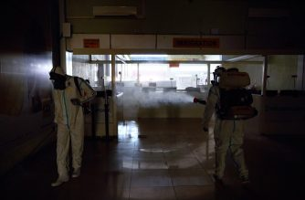 Airport staff members disinfect Juba International Airport in Juba, South Sudan on April 3, 2020. - An aircraft that landed in Juba, along with the country's main airport, were disinfected of any potential traces of COVID-19 coronavirus after hosting passengers who had recently arrived in South Sudan from neighbouring Sudan. (Photo by Alex McBride / AFP)
