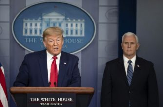 US President Donald Trump, flanked by US Vice President Mike Pence, speaks during the daily briefing on the novel coronavirus, COVID-19, in the Brady Briefing Room at the White House on April 3, 2020, in Washington, DC. (Photo by JIM WATSON / AFP)