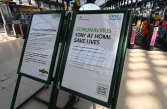 A sign at Brighton railway station repeats government advice to stay at home and aoiv all non-essential travel in Brighton, on the south coast of England, on April 5, 2020, as the warm weather tests the nationwide lockdown to combat the novel coronavirus pandemic. - The daily toll of deaths from COVID-19 has been steadily increasing by more than 500 deaths a day this week and the country is bracing for an expected peak in the next week to 10 days. (Photo by Glyn KIRK / AFP)