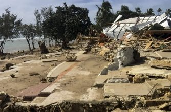 """This handout photo taken and released by the Tonga Police on April 9, 2020 shows damage to a tourist resort cause by Tropical Cyclone Harold in the Hihifo coastal area. - A resurgent Tropical Cyclone Harold flattened tourist resorts in Tonga on April 9, extending a week-long trail of destruction across four South Pacific island nations that has claimed more than two dozen lives. (Photo by Handout / TONGA POLICE / AFP) / -----EDITORS NOTE --- RESTRICTED TO EDITORIAL USE - MANDATORY CREDIT """"AFP PHOTO / TONGA POLICE"""" - NO MARKETING - NO ADVERTISING CAMPAIGNS - DISTRIBUTED AS A SERVICE TO CLIENTS"""