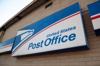 A sign is seen outside a United States Postal Service (USPS) post office location in Washington, DC, April 16, 2020. - For many Americans, checking the mailbox is a daily ritual, a constant in a quickly changing world that can yield anything from wedding invitations to tax audits to new clothes. But as with many ordinary things as the coronavirus crisis unfolds, the US Postal Service -- already compromised by a mountain of debt -- has a most uncertain future. (Photo by SAUL LOEB / AFP)