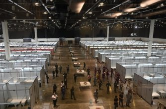 This general view a hall converted into a 500-bed capacity COVID-19 coronavirus quarantine facility at the World Trade Center in Manila on April 23, 2020, one of the facilities to house mild cases of the disease. - The facility will be managed by military medical personnel. (Photo by Ted ALJIBE / AFP)