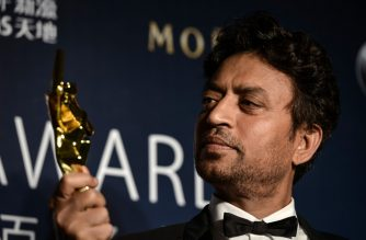 "(FILES) In this file photo taken on March 27, 2014 Best Actor winner Irrfan Khan poses with his trophy during the Asian Film Awards in Macau. - Acclaimed Indian actor Irrfan Khan, whose international movie career included hits like ""Slumdog Millionaire"", ""Life of Pi"" and ""The Amazing Spider-Man"", has died aged just 53, his publicist said on April 29, 2020. (Photo by Philippe LOPEZ / AFP)"