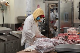 NEW YORK, NY - APRIL 17: A butcher processes some meat at Vincents Meat Market on April 17, 2020, in Bronx borough of New York City. Some of the country's largest meat processing plants closed due to the COVID-19 outbreak after a factory in South Dakota was closed after nearly 300 of its 3,700 employees tested positive.   David Dee Delgado/Getty Images/AFP