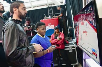 LOS ANGELES, CA - FEBRUARY 16: NBA2K guru ?Ronnie 2K? challenges fans to a hoops competition at Ruffles? ?The RIDGE? 4 point-line footprint in Los Angeles during NBA All-Star festivities on February 16, 2018.   Emma McIntyre/Getty Images for Ruffles/AFP