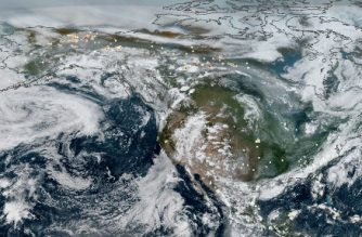 """This NOAA handout true-color composite image obtained from NASA on July 29, 2019 shows smoke from Arctic wildfires spreading across Alaska and Canada captured by both GOES East and GOES West on July 23, 2019. - Since June 2019, which was the hottest June on record, there have been more than 100 intense wildfires in the region. With July currently on track to become the hottest July on record, with heatwaves occurring across Europe and the United States, scientists are bracing for more while describing the conflagrations as """"unprecedented."""" The fires themselves, overlaid onto the image as yellow-red dots, were gathered using the VIIRS sensor onboard NOAA-20, which provides daily, high-resolution visible and infrared images of Earth's atmosphere from across the globe.  The wildfires are estimated to have released roughly 100 megatons of carbon dioxide (CO2) into the atmosphere between June 1 and July 21, according to the Copernicus Atmosphere Monitoring Service. This is about as much as Belgium's total carbon output for 2017. (Photo by HO / NASA/NOAA / AFP) / RESTRICTED TO EDITORIAL USE - MANDATORY CREDIT """"AFP PHOTO / NASA/NOAA/HANDOUT"""" - NO MARKETING - NO ADVERTISING CAMPAIGNS - DISTRIBUTED AS A SERVICE TO CLIENTS"""
