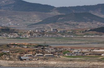 A general view shows fields and buildings of the North Korean countryside outside Kaesong, seen across the Demilitarized Zone (DMZ) from the South Korean island of Ganghwa on April 23, 2020. - The United States will keep seeking North Korea's denuclearization no matter who is in charge in Pyongyang, Secretary of State Mike Pompeo said, amid speculation about leader Kim Jong Un's health. (Photo by Ed JONES / AFP)