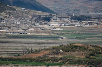 (File photo) A general view shows fields and buildings of the North Korean countryside outside Kaesong, seen across the Demilitarized Zone (DMZ) from the South Korean island of Ganghwa on April 23, 2020. - The United States will keep seeking North Korea's denuclearization no matter who is in charge in Pyongyang, Secretary of State Mike Pompeo said, amid speculation about leader Kim Jong Un's health. (Photo by Ed JONES / AFP)