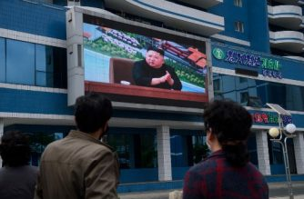 People watch a screen showing a broadcast of the completion ceremony of the Sunchon Phosphatic Fertilizer Factory attended by North Korean leader Kim Jong Un at Mirae Scientists Street in Pyongyang on May 2, 2020. - North Korea's Kim Jong Un has made his first public appearance in nearly three weeks, state media reported, following intense speculation that the leader of the nuclear-armed nation was seriously ill or possibly dead. (Photo by KIM Won Jin / AFP)