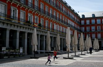 """Two kids play next to the closed terrace of a bar at the Plaza Mayor square in Madrid, on May 6, 2020, during a national lockdown to prevent the spread of the COVID-19 disease. - Spanish prime minister today warned that abruptly ending nearly eight weeks of lockdown would be """"unforgivable"""" as he sought parliamentary approval to re-extend the state of emergency. (Photo by Gabriel BOUYS / AFP)"""