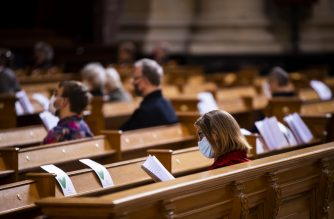 Members of the congregation wear face masks and observe social during a Sunday service at the Berliner Dom cathedral in Berlin on May 10, 2020, amid the Covid-19 coronavirus pandemic. - The German capital's Protestant Cathedral reopened for worshippers on Sunday after being online only for two months, due to restrictions and social distancing rules implemented to limit the spread of the virus. (Photo by Odd ANDERSEN / AFP)