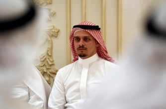"""(FILES) In this file photo Salah Khashoggi, the son of murdered Saudi journalist Jamal Khashoggi, and his relatives receive mourners at an events hall in the Saudi coastal city of Jeddah on November 16, 2018. - The sons of murdered Saudi journalist Jamal Khashoggi said Friday that they """"forgive"""" the killers of their father. """"We the sons of martyr Jamal Khashoggi announce we forgive and pardon those who killed our father,"""" the Washington Post columnist's son Salah Khashoggi said on Twitter. (Photo by Amer HILABI / AFP)"""