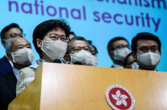 """Hong Kong Chief Executive Carrie Lam (front L) holds a press conference after attending the opening session of the National People's Congress (NPC) at the Great Hall of the People in Beijing, in Hong Kong on May 22, 2020. - A proposal to enact new Hong Kong security legislation was submitted to China's rubber-stamp in Beijing on May 22, state media said, a move expected to fan fresh protests in the semi-autonomous financial hub. City leader Carrie Lam, who is attending the NPC, vowed to """"fully cooperate"""" with Beijing over the national security proposal and complete the legislation """"as soon as possible"""". (Photo by Anthony WALLACE / AFP)"""
