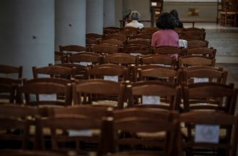 People attend a mass on May 23, 2020 at the Saint Jean-Baptiste church in Neuilly-sur-Seine on the outskirts of Paris, after France's allowed religious gathering after weeks of closed churches as part of the measures to curb the spread of the COVID-19. (Photo by STEPHANE DE SAKUTIN / AFP)