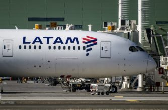 A Latam airlines plane sits on the tarmac at Santiago International Airport, in Santiago on May 26,2020, during the new coronavirus, COVID-19, pandemic. - Latin America's biggest airline, the Brazilian-Chilean group LATAM, filed for bankruptcy in the US, according to a statement on May 25, 2020. Shares in Latin America's largest airline plunged 35 percent on the Santiago stock exchange following  the filing for bankruptcy. (Photo by Martin BERNETTI / AFP)