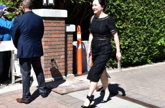 Chinese Huawei tech executive Meng Wanzhou leaves her Vancouver home on May 27 ,2020, to appear in British Columbia Supreme Court. - Meng Wanzhou was dealt a legal setback Wednesday when a Canadian judge ruled that proceedings to extradite her to the US will continue. The decision, which also dashes hopes for a quick fix of Canada-China relations, which soured following her arrest in 2018, found that bank fraud accusations against Meng would stand up in Canada, a key test for extradition. (Photo by Don MacKinnon / AFP)