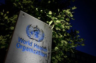 A photo taken in the late hours of May 29, 2020 shows a sign of the World Health Organization (WHO) at their headquarters in Geneva amid the COVID-19 outbreak, caused by the novel coronavirus. - President Donald Trump said May 29, 2020, he was breaking off US ties with the World Health Organization, which he says failed to do enough to combat the initial spread of the novel coronavirus. (Photo by Fabrice COFFRINI / AFP)