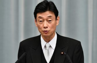 Newly appointed Japanese State Minister in charge of Economic Revitalisation Yasutoshi Nishimura, speaks during a press conference at the prime minister's official residence in Tokyo on September 11, 2019. - Japan's Prime Minister Shinzo Abe on September 11 appointed new foreign and defence ministers and promoted a popular rising political star, in a cabinet reshuffle that fuelled speculation over the prime minister's successor. (Photo by Toshifumi KITAMURA / AFP)