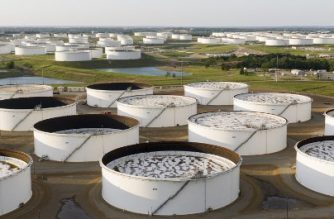 An aerial view of a crude oil storage facility is seen on May 4, 2020 in Cushing, Oklahoma. - Using his fleet of drones, Dale Parrish tracks one of the most sensitive data points in the oil world: the amount of crude stored in giant steel tanks in Cushing, Oklahoma. The West Texas Intermediate oil stored in the small town in the midwestern United States is used as a reference price for crude bought and sold by refiners in Asia, hedge funds in London and traders in New York. (Photo by Johannes EISELE / AFP)