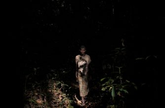 Henriette Memba, a picker of the Bayaka pygmy traditional medicine, walks in the equatorial forest in search of medicinal plants, in Bayanga, on March 13, 2020. - Since the beginning of the COVID-19 coronavirus pandemic, the authorities of the Dzanga-Sangha Park have been pushing pygmies into the forests. The displeases farmers take advantage of the pygmies to get free or very low paid labour for illegal diamond mines and agricultural fields. (Photo by FLORENT VERGNES / AFP)