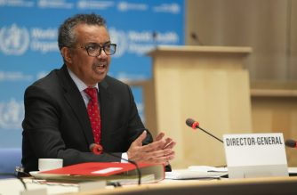"""This handout image provided by the World Health Organization (WHO) on May 22, 2020 in Geneva shows WHO Director-General Tedros Adhanom Ghebreyesus attending the 147th session of the WHO Executive Board held virtually by videoconference, amid the COVID-19 pandemic, caused by the novel coronavirus. (Photo by Christopher Black / World Health Organization / AFP) / RESTRICTED TO EDITORIAL USE - MANDATORY CREDIT """"AFP PHOTO / WORLD HEALTH ORGANIZATION / CHRISTOPHER BLACK"""" - NO MARKETING NO ADVERTISING CAMPAIGNS - DISTRIBUTED AS A SERVICE TO CLIENTS"""