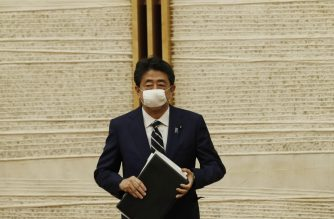 Japan's Prime Minister Shinzo Abe leaves after a news conference in Tokyo on May 25, 2020. - Japan lifted a nationwide state of emergency over the coronavirus on May 25, gradually reopening the world's third-largest economy as government officials warned caution was still necessary to prevent another wave. (Photo by KIM KYUNG-HOON / POOL / AFP)