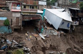 View of houses devastated by the overflowing of a creek due to the torrential rains caused by the passage of tropical storm Amanda in San Salvador on May 31, 2020. - Tropical storm Amanda, the first named storm of the season in the Pacific, lashed El Salvador and Guatemala on Sunday, leaving nine people dead amid flooding and power outages. (Photo by Yuri CORTEZ / AFP)