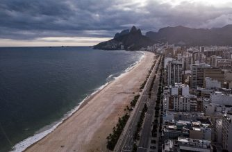 (FILES) This file aerial picture taken on April 1, 2020 shows the empty Ipanema beach in Rio de Janeiro, Brazil. - The Mayor of Rio de Janeiro, Marcelo Crivella, announced a gradual plan of economic reopening as of June 2, which foresees the resumption of activities such as religious services and water sports on the beach without crowds. (Photo by FLORIAN PLAUCHEUR / AFP)