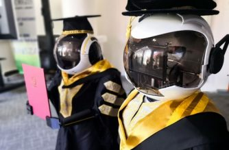 "This undated handout photo released by the University Sultan Zainal Abidin on June 2, 2020 shows two robots named Seebaa (R) and Naseem (L) wearing graduation robes are pictured during a simulation in Terengganu. - A Malaysian university in the eastern state is looking at robots to stand in for graduating students amid fears over the spread of the COVID-19 coronavirus. (Photo by Handout / UNIVERSITY SULTAN ZAINAL ABIDIN / AFP) / -----EDITORS NOTE --- RESTRICTED TO EDITORIAL USE - MANDATORY CREDIT ""AFP PHOTO / UNIVERSITY SULTAN ZAINAL ABIDIN "" - NO MARKETING - NO ADVERTISING CAMPAIGNS - DISTRIBUTED AS A SERVICE TO CLIENTS - NO ARCHIVE"