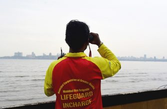 A city civic lifeguard checks an area at the Dadar Beach ahead of a cyclonic storm that may hit the North Maharashtra and Gujarat coast, in Mumbai on June 2, 2020. - More than 10,000 people, including some coronavirus patients, were moved to safer locations on June 2 as India's west coast braced for a cyclone, the first such storm to threaten Mumbai in more than 70 years. (Photo by Sujit Jaiswal / AFP)