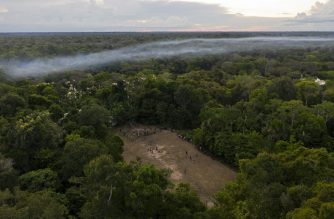 (FILES) This file aerial picture taken on March 15, 2020 shows a football game taking place in a forest clearing in the Bauana community, municipality of Carauari, in the heart of the Brazilian Amazon Forest. - Vast tracts of pristine rainforest on three continents went up in smoke last year, with an area roughly the size of Switzerland cut down or burned to make way for cattle and commercial crops, the Global Forest Watch said in its annual report on June 2, 2020, based on satellite data. Brazil accounted for more than a third of the loss, with the Democratic Republic of Congo and Indonesia a distant second and third. (Photo by Florence GOISNARD / AFP)