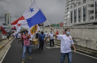 """Members of Panama unions protest against the reopening measures adopted by the Panamanian government after the quarantine that was decreed to prevent the spread of the new coronavirus COVID-19 pandemic, in front of the Labor Ministry's headquarters, in Panama City on June 2, 2020. - The government of Panamanian President Laurentino Cortizo, reopened on Monday the construction, non-metallic mining and industry sectors, which were inactive to combat COVID-19, in an attempt to """"avoid the economic collapse"""" of the country with the highest number of infections in Central America. (Photo by Luis ACOSTA / AFP)"""