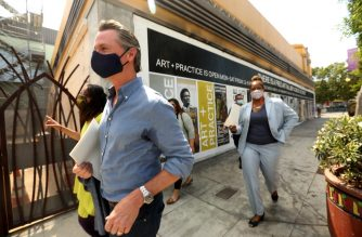 California Governor Gavin Newsom (L front) takes a tour of businesses in Leimert Park with California Assembly Member Sydney Kamlager-Dove (L) and California Senator Holly Mitchell (R) after days of protests in Los Angeles in Leimert Park in Los Angeles on June 3, 2020, as the state opens from the coronavirus shutdown. (Photo by Genaro Molina / POOL / AFP)