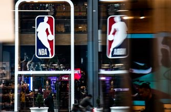 (FILES) In this file photo taken on March 12, 2020, an NBA logo is shown at the 5th Avenue NBA store in New York City. - The NBA is finalizing details of a plan which is expected to be approved by the league's Board of Governors on June 4, 2020, paving the way for a return from the coronavirus shutdown. The board is poised to give the green light to commissioner Adam Silver's return of basketball which would begin July 31 with a 22-team format, and end in mid-October with a champion being crowned, ESPN reported. (Photo by Jeenah Moon / GETTY IMAGES NORTH AMERICA / AFP)