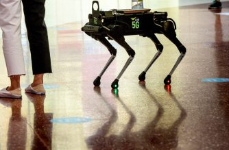 A 5G K9 robot distributes hand sanitiser to visitors in a shopping mall in Bangkok on June 4, 2020, as sectors of the economy reopen following restrictions to halt the spread of the COVID-19 novel coronavirus. (Photo by Mladen ANTONOV / AFP)