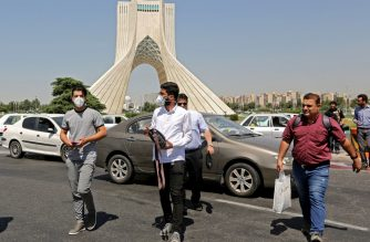 Iranians, mostly wearing face masks, are pictured at Azadi square in the capital Tehran on June 16, 2020 amid the coronavirus Covid-19 pandemic crisis. - The Islamic republic has struggled to contain what has become the Middle East's deadliest outbreak of the COVID-19 illness since it reported its first cases in the Shiite holy city of Qom in February. (Photo by ATTA KENARE / AFP)