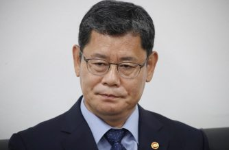 South Korean Unification Minister Kim Yeon-chul reacts as he meets with reporters to announce his offering to resign over the worsening of inter-Korean relations at the government complex in Seoul on June 17, 2020. - North Korea threatened June 17 to bolster its military presence in and around the Demilitarized Zone, a day after blowing up its liaison office with the South, prompting sharp criticism from Seoul. (Photo by - / YONHAP / AFP) / - South Korea OUT / REPUBLIC OF KOREA OUT  NO ARCHIVES  RESTRICTED TO SUBSCRIPTION USE