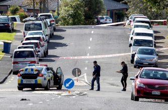 """Police officers cordon off an area after a shooting incident in a residential neighbourhood in Auckland on June 19, 2020. - An unarmed New Zealand police officer was shot dead on an Auckland street on June 19 in a rare fatal attack that Prime Minister Jacinda Ardern described as """"devastating"""". (Photo by GREG BOWKER / AFP)"""