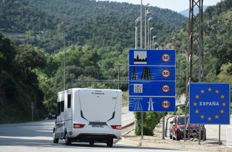 A van drives into Spain after crossing the French-Spanish border at La Jonquera on June 21, 2020. - Traffic flowed again across Spain's border with France as the last of the strict Spanish coronavirus restrictions introduced in March were eased. (Photo by Josep LAGO / AFP)