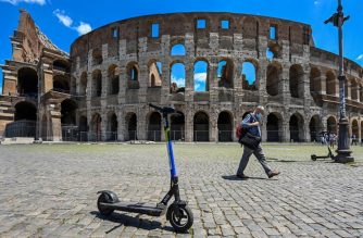 A view shows shared electric scooters parked in front of the Coliseum monument on June 22, 2020 in Rome, as the country eases its lockdown aimed at curbing the spread of the COVID-19 infection, caused by the novel coronavirus. - With deconfinement and good weather, self-service shared electric scooters have invaded the streets of Rome in recent days, a novelty in the Eternal City, which in turn is discovering the joys and nuisances of new forms of mobility. (Photo by Vincenzo PINTO / AFP)