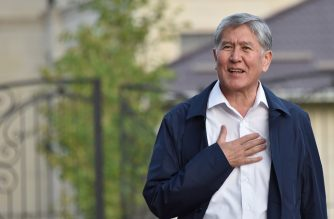 (FILES) In this file photo taken on June 27, 2019 Former Kyrgyz president Almazbek Atambayev stands outside his residence in the village of Koi-Tash near the capital Bishkek. - Kyrgyzstan's former president was sentenced to 11 years in jail on June 23, 2020 over the illegal release of a crime boss, in a case that caused a power struggle with his successor to turn violent. (Photo by Vyacheslav OSELEDKO / AFP)