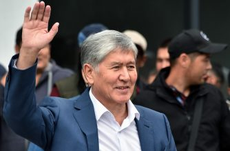 (FILES) In this file photo taken on July 03, 2019 Former Kyrgyzstan's president Almazbek Atambayev waves to his supporters as he attends a rally in Bishkek. - Kyrgyzstan's former president was sentenced to 11 years in jail on June 23, 2020 over the illegal release of a crime boss, in a case that caused a power struggle with his successor to turn violent. (Photo by Vyacheslav OSELEDKO / AFP)