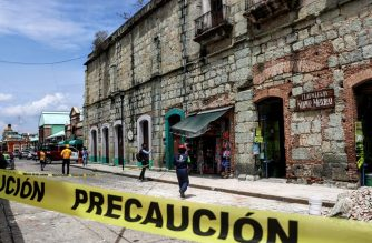 Security tape alerts people of a damaged building after a quake in Oaxaca, Mexico on June 23, 2020. - A 7.1 magnitude quake was registered Tuesday in the south of Mexico, according to the Mexican National Seismological Service. (Photo by PATRICIA CASTELLANOS / AFP)