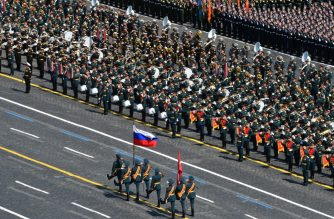 "This handout picture provided by Host photo agency shows honour guards marching with flags on Red Square during a military parade, which marks the 75th anniversary of the Soviet victory over Nazi Germany in World War Two, in Moscow on June 24, 2020. - The parade, usually held on May 9, was postponed this year because of the coronavirus pandemic. (Photo by Evgeny Biyatov / Host photo agency / AFP) / RESTRICTED TO EDITORIAL USE - MANDATORY CREDIT ""AFP PHOTO / Host photo agency / Evgeny Biyatov"" - NO MARKETING NO ADVERTISING CAMPAIGNS - DISTRIBUTED AS A SERVICE TO CLIENTS --- NO ARCHIVE ---"