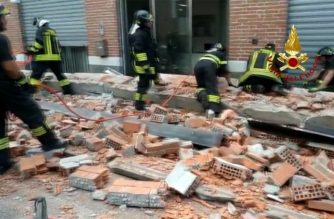 """A photo grabbed from a video taken and handout on June 24, 2020 by the Italian Corps of Firefighters (Vigili del Fuoco) shows an Urban Search And Rescue team working at the site of a building collapse in Albizzate, near Varese, northern Italy, that killed a woman and her two children who were walking along the building's wall. (Photo by Handout / Vigili del Fuoco / AFP) / RESTRICTED TO EDITORIAL USE - MANDATORY CREDIT """"AFP PHOTO / VIGILI DEL FUOCO / HANDOUT"""" - NO MARKETING NO ADVERTISING CAMPAIGNS - DISTRIBUTED AS A SERVICE TO CLIENTS ---"""