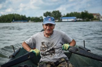 Fisherman Iosif Acsente,74, rows after he installed his fishing nets on Sfantu Gheorghe Danube's branch in Sfantu Gheorghe village June 17, 2020. - Included on Unesco's World Heritage list, this natural paradise spread across 58,000 square kilometres hosts over 300 species of bird and 45 freshwater fish species. The village Sfante Gheorghe has lost around 1,500 people since the transition away from communism in the early 1990s and now numbers just some 500 souls. (Photo by Daniel MIHAILESCU / AFP)