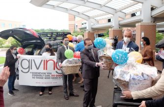 Ministers from the Iglesia Ni Cristo (Church of Christ) present a gift basket to Paul Gaden, President of Sentara Princess Anne Hospital. (Screenshot from INC Giving)
