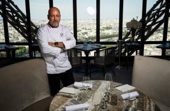 """Starred French chef Frederic Anton poses during a photo session at the """"Le Jules Verne"""" restaurant at the Effeil Tower in Paris on July 15, 2019. - Anton is the new chef of the restaurant Jules Verne, situated at 125 meters from the ground on the Eiffel Tower. In this establishment with a breathtaking view that opens its doors on July 20, 2019 in a completely redecorated scernery, the 54-year-old chef of the restaurant Pre Catelan in the Bois de Boulogne (three Michelin stars) succeeds the famous Alain Ducasse, at the end of a war of chiefs much publicized. (Photo by Lionel BONAVENTURE / AFP)"""